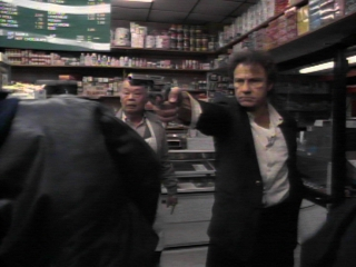 Harvey Keitel shoots his gun in a store!